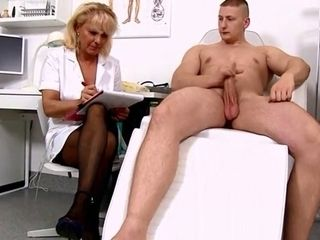 Mature blondie Nurse measures patients shaft sensitized and swell