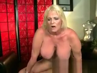 Huge-chested mature mother in torn nylon