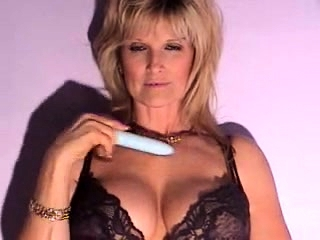 Mature blond playing