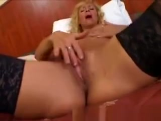 Platinum-blonde Mature sport cutie Plays With A giant fuck stick