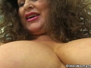 English cougar Gilly pumps her humid pussy with a faux-cock