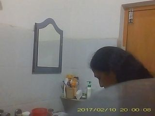 Covert web cam take hold of of Desi Aunty switching