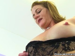 English cougar Jozie wears her crotchless stockings for a reason