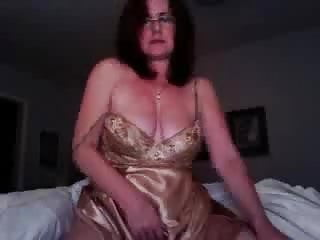 Mature toying on web cam