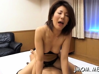 Enormous breasted chinese mature gets humped firm in from behind