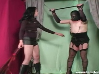 Dominatrix in shoes fastening nip clips on a sissy and cropping him