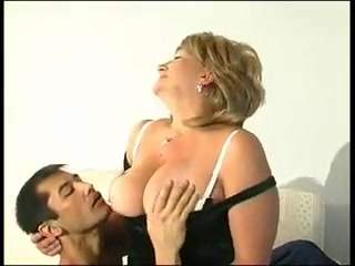 Light-haired grannie in tights turns on a younger guy