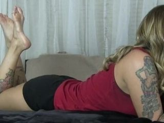Kleio Valentien overlooks you while she plays on her smartphone she wags her soles
