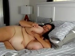 Plumper mother in couch