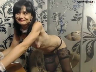 Thin mature demonstrates figure on webcam