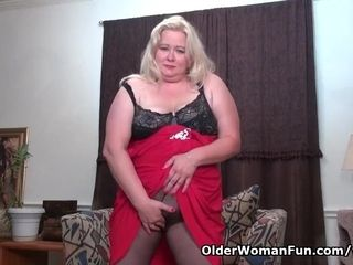Plus-size cougar strokes from the USA luvs dildoing her puss