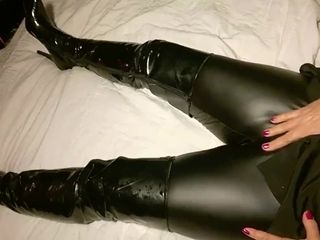 Glossy spandex trousers and high shoes