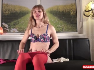 Candid honey cougar mature woman attempts on translucent undergarments on the bed.