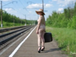 Bare traveling with hat and high-heeled slippers only