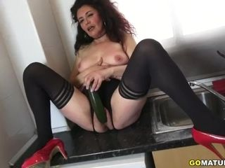 Spanish housewife Zazel Paradise toying with a cucumber
